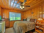 A plush queen bed and a cozy wood-paneled interior ensure peaceful sleeping.