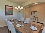 The dining room features stylish chairs and a large wooden table.
