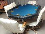 Poker table in games room