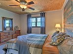 Another queen bed highlights this nicely decorated bedroom.