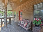 Enjoy some fresh air on the furnished porch.