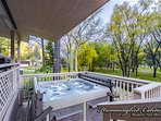 Hot tub is right off the covered patio so you can relax and have a beautiful, open view