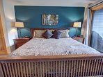 Enjoy the king size bed and private patio in the master bedroom.