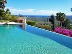 Heated Infinity Swimming Pool with diving board, water slide and amazing views!