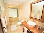 The Master Bedroom comes with a King Size Bed, acces to the balcony and Ensuite private bathroom.
