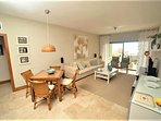 The spacious living room comes with an open kitchen, dining area, lounge area and amazing ocean view