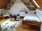 The children's room has a single bed and a bunk-bed