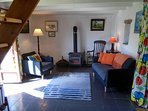 The lounge opens onto the private sunny garden and there is a wood-stove for winter