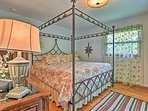 The master bedroom boasts an elegant 4-post king bed.