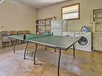 Head into the converted garage to access the laundry machines and ping pong table.
