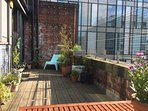 The private roof terrace on a sunny afternoon.
