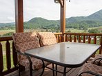 Dinner with a view!Enjoy your dinner time on the 48' covered deck with views of the mtns & valley's!