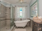 Guest bath room with separate tub and shower.