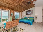 3rd level oceanfront master bedroom with king sized bed and flat screen TV.