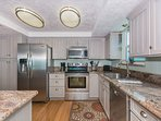 Spacious updated kitchen with granite counter tops and stainless steel appliances.