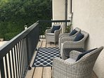 Balcony off living room with sweeping views.  A great place to enjoy morning coffee or evening wine