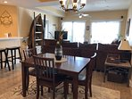 Plenty of seating. Dining table for 4 with extra chairs in master closet plus 4 barstools at counter