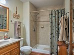 The bathroom also features a walk-in shower.