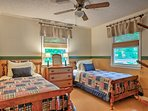 Tuck the kids into the 2 twin beds in this room.