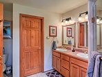 Prepare for a night on the town in this large bathroom.