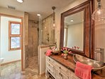 Rinse off the day in this gorgeous en-suite bathroom.