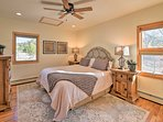 This master bedroom boasts a king bed.
