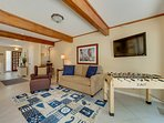 Enjoy foosball and the flat panel TV in this living space