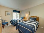 Bedroom 3 has 2 twin beds and bathroom access with standing shower