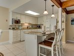 Large, updated kitchen is the true hub of this space. Breakfast bar offers high top seating for two