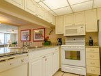 Plenty of room in this kitchen for cooking with family and friends!  You'll love the washer dryer that's tucked away in...