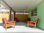 The porch curtains provide extra privacy and shade.  There's a wood fire pit located in the back yard, too.  Great for...