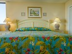 The Coastal Escape Master Bedroom has a king-sized bed that is just waiting for you after all your fun in the sun!