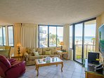 Surfside Sandcastle is decorated with a tropical flair that will make you feel right at home while you are on...