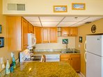 Your modern, updated kitchen has beautiful oak cabinets and granite counter tops.  It's fully equipped for preparing...
