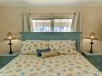 The Blue Seas Master Bedroom has a luxurious king bed with a pillow top mattress and high thread count sheets for...