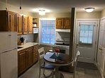 Fully equipped kitchen & entrance into the unit