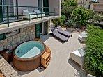 Lower terrace with the hot tub, solar shower and the sun bath area; balcony