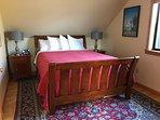 Spacious bedroom.   Stearns and Foster mattress.  Original artwork.
