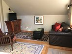 Bright and sunny.  Hardwood floors. Hand knotted rugs. Original artwork.