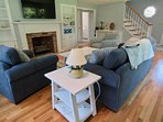 Family room with stairs to bedroom with 4 twin beds.
