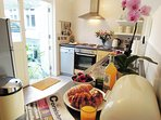 Well equipped kitchen opens to sunny terrace