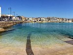 Beautiful St Ives harbour is just 2 minutes walk away