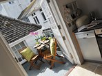 Kitchen opens up to sunny terrace