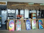 The poolside Tiki Hut sells quick snacks and drinks as well as everything you need for the BEACH!