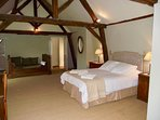 The Vaulted Master bedroom with a King bed & an antique French double bed, with ensuite shower room