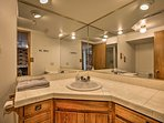This bathroom has plenty of space for you to get ready in the morning.