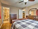 This bedroom has a queen bed and an en-suite bathroom.