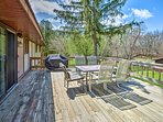 The spacious wraparound deck is perfect for hosting a barbecue.