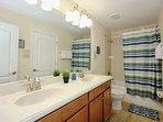 Upstairs Hall Shared Bath w/Double Sinks & Shower/Tub Combination