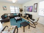 Living Area w/Comfortable Leather Seating, Flat Screen TV & Pool Access